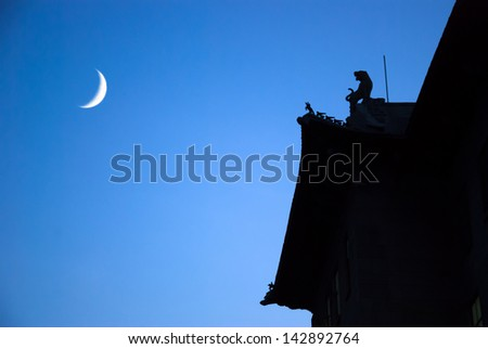 Rooftop of pavilion styles teaching building in Harbin Engineering University in the evening, located in Harbin City, Heilongjiang Province, China. - stock photo