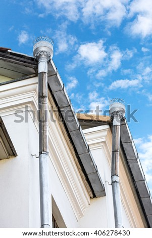rooftop rain gutter on house with blue sky background  - stock photo