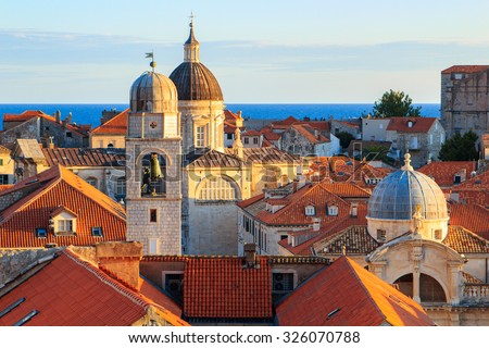 Rooftop View at sunset of buildings and church of old fortress in Dubrovnik, Croatia - stock photo