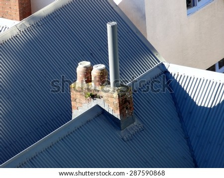 Rooftop view of chimneys on old colonial house, Wellington New Zealand - stock photo