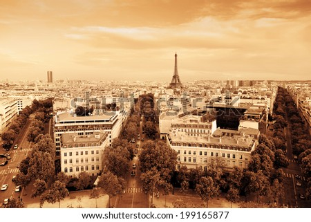 Rooftop view on the Eiffel Tower from Arc de Triomphe. Sunny day, blue sky. Tour Eiffel. Vintage style, monochrome gold