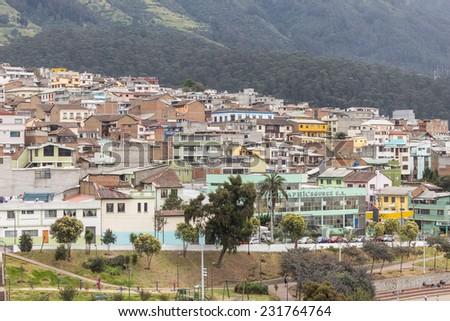 rooftops along pichincha mountain Quito Ecuador South America - stock photo