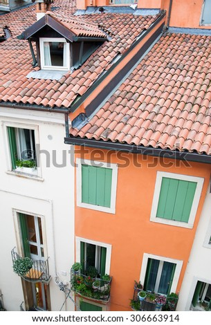 Rooftops and facades of typical houses of Vicenza, North Italy - stock photo