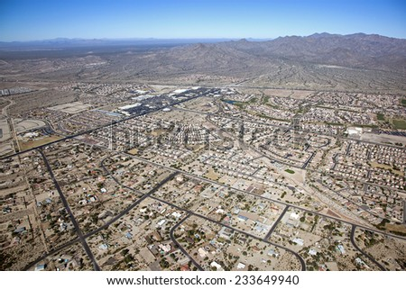 Rooftops and retail over Buckeye, Arizona - stock photo