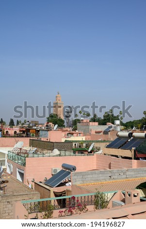 Rooftops in Marrakesh, Morocco with blue sky and solar panels.