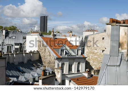 rooftops of Paris France Europe tallest office building Montparnasse Tour Tower in distance - stock photo