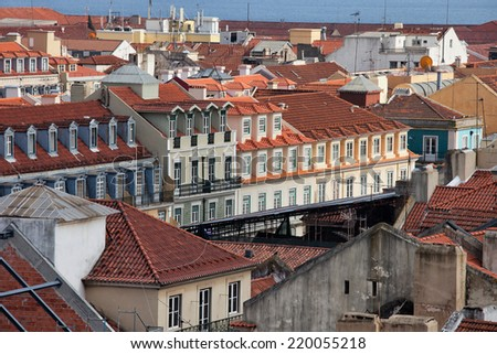 Rooftops of tenement houses in Lisbon, Portugal. - stock photo