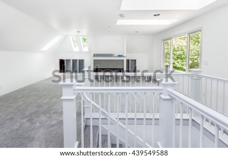 Room and stairs carpeted in pale gray during remodeling - stock photo