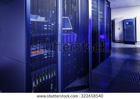 room data center rows of computer equipment - stock photo