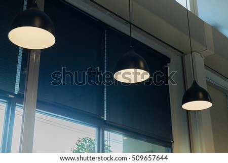 Room decorated retro hanging lamp , stock photo