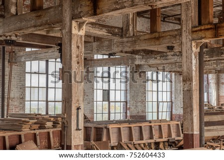 Room In Old Warehouse With Rustic Brick Wall And Distressed Wood Beams Large Windows