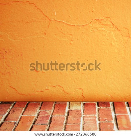 room interior vintage with brick wall and cement orange floor background - stock photo