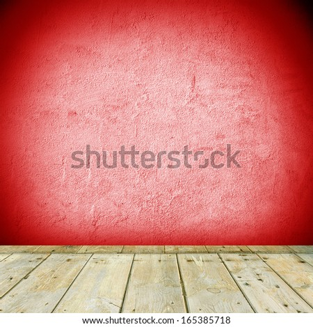 Room interior vintage with wood floor on a red wall - stock photo
