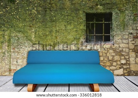 Room interior with blue sofa and mossy wall - stock photo
