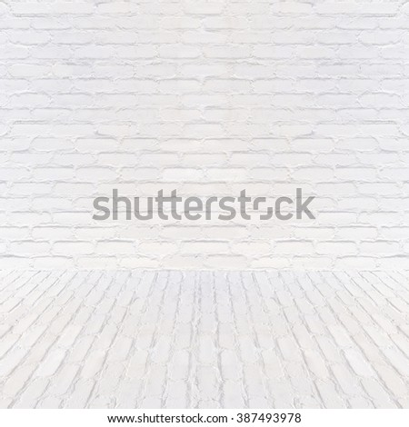 Room interior with white brick wall and floor - stock photo