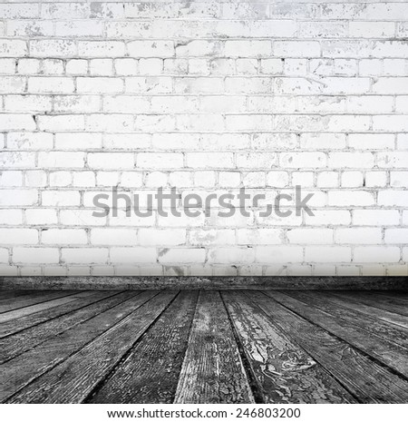 Room interior with white brick wall and wood floor  - stock photo
