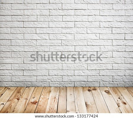 Room interior with white brick wall and wood floor background - stock photo