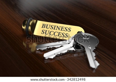 Room key with golden keychain business success concept on the wooden background - stock photo