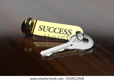 Room key with golden keychain success concept on the wooden background - stock photo