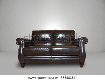 Room, leather sofa in a grey room - stock photo