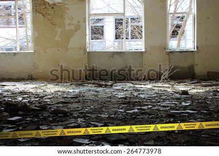Room of the deserted School in Chernobyl Zone. Ukraine. Signs of radiation hazard - stock photo