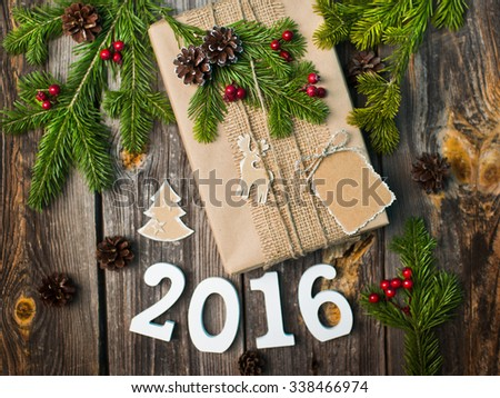 Room 2016 on the wooden background with Christmas decorations - stock photo