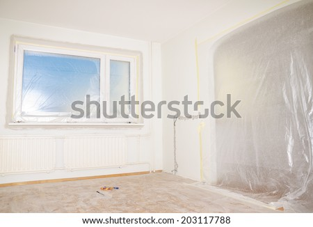 Room renovation. White room repair with dirty floor. - stock photo