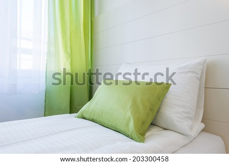 Room setting with bed and pillows - stock photo