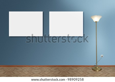 Room wall interior with empty white picture frames and lamp - stock photo