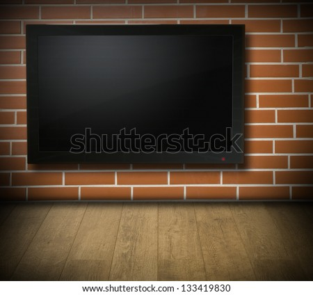 Room with blank TV screen on red brick wall - for Your text or picture - stock photo