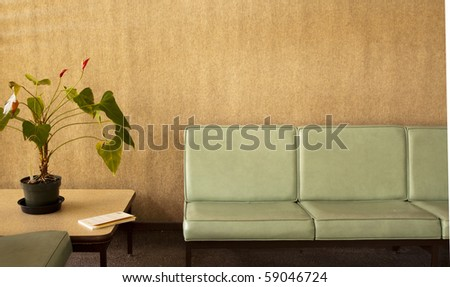 Room with chairs, potted plant and a book - stock photo