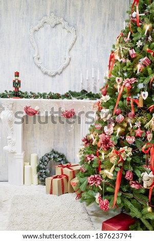Room with decorative fireplace decorated to christmas celebration - stock photo
