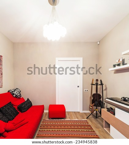 Room with furniture and guitar. - stock photo