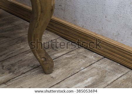 Room with old wood floor and rough plaster walls.  - stock photo