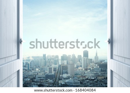 room with open door to city - stock photo