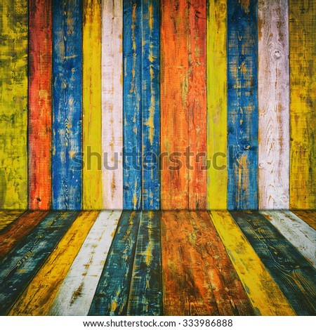 Room with Wall and Floor Made from Multicolored Planks - stock photo