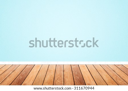 room wood floor and light blue pastel wallpaper. interior  - stock photo