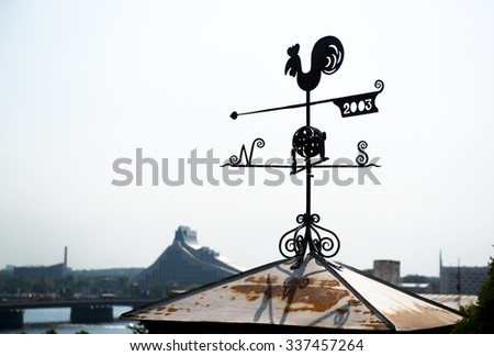 Rooster weather vane in Riga, Latvia. Northern Europe - stock photo