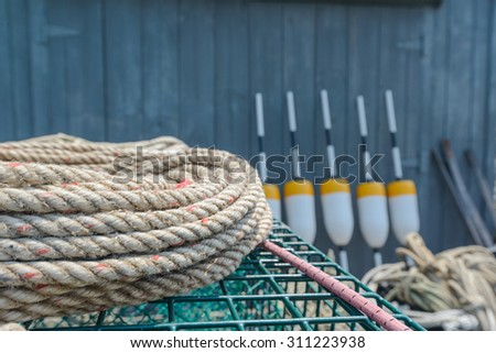 Rope and lobster floats stacked and ready to board the outbound lobster boats - stock photo