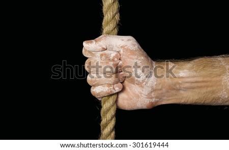 Rope in hand. Hand - stock photo