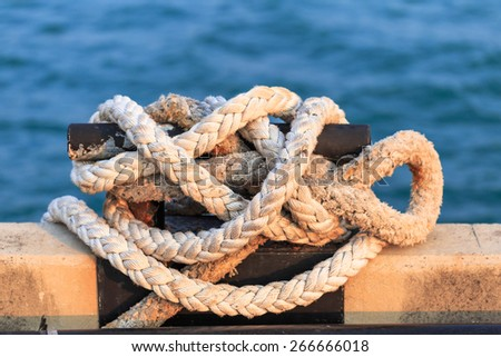 rope mooring at the port in nature background - stock photo
