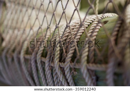 Rope net on the wooden fence. Selective focus