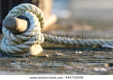 Rope on jetty, Lake Cayuga at Ithaca, New York - stock photo