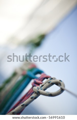Rope on sailing boat in the sea - stock photo