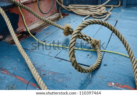 Rope on the fisherman boat. - stock photo