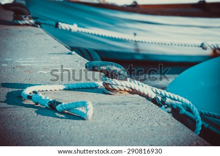 Rope on the prow sea knot transport - stock photo