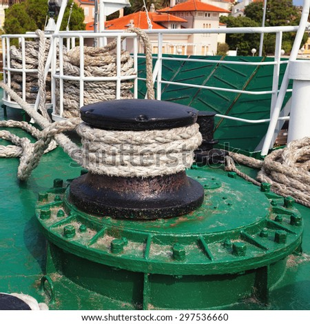 rope winch with thick rope during mooring on larger passenger  ship - stock photo
