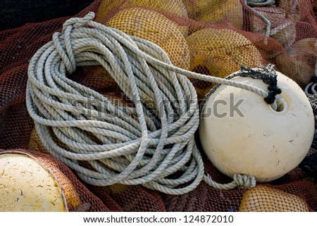 Rope with buoy attached - stock photo
