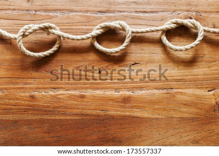 rope with knots on wood