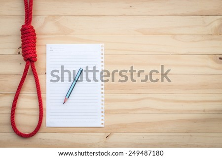 Rope with knotted and paper note on wooden background - stock photo